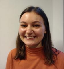 A headshot of Senior Coordinator Lara, who is smiling at the camera.